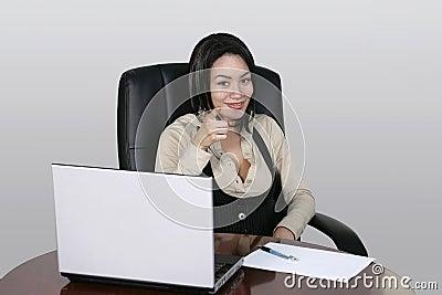 Brunette working at her office desk