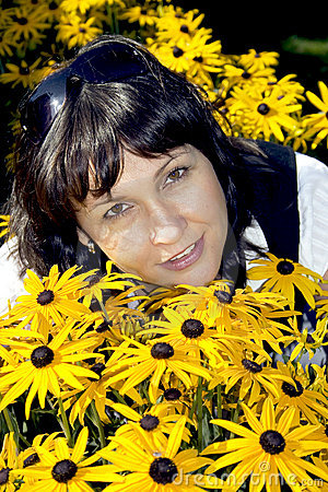 Brunette in yellow flowers
