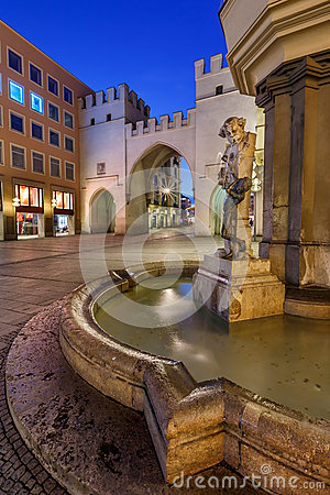 Free Brunnenbuberl Fountain And Karlstor Gate Stock Photography - 37717492