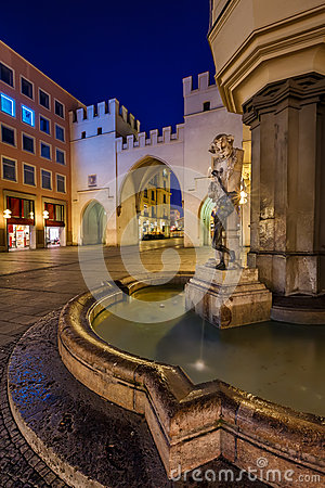 Free Brunnenbuberl Fountain And Karlstor Gate Royalty Free Stock Photo - 38866675