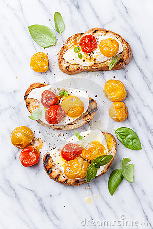 Free Bruschetta With Tomatoes And Mozzarella Royalty Free Stock Images - 42745799