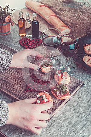 Free Bruschetta. Woman Is Cooking Romantic Dinner. Toned Photo. Valentine Day. Love. Royalty Free Stock Photography - 84003527