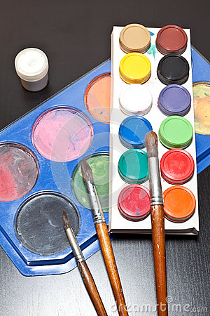 Brushes and colored paint artist