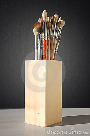 Brushes for painting in a wooden glass