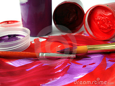 Brushes and red paint jar