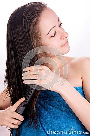 Brushing her hair