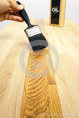 Brushing oil onto a wood surface
