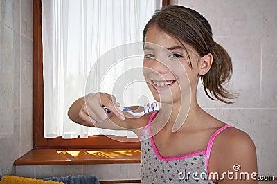 Brushing teeth in bathroom