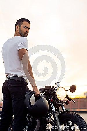Free Brutal Man Near His Cafe Racer Custom Motorbike. Royalty Free Stock Image - 96807796