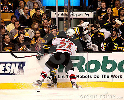 Bryce Salvador checks Shawn Thornton (NHL Hockey) Editorial Photo