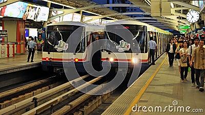 BTS Trains or Skytrains at a Station in Bangkok Editorial Stock Photo