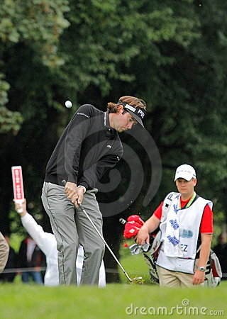 Bubba Watson chips onto the green. Editorial Image