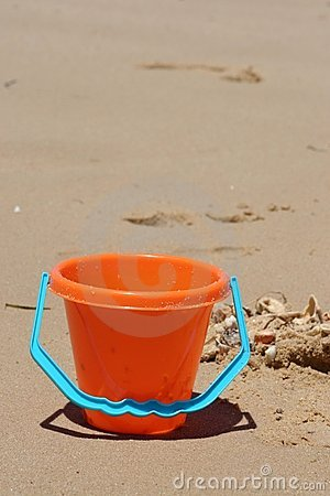 Bucket on Beach with Shells