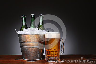 Bucket of Beer With Mug on Wood