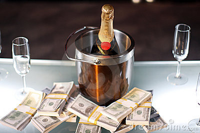 Bucket of champagne next to cash