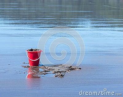 Bucket of sand on beach
