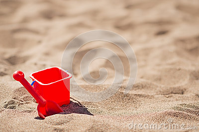 Bucket and shovel on the sandy beach