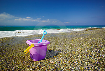 Bucket and spade on the beach sand