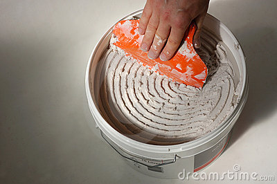 Bucket of tile adhesive