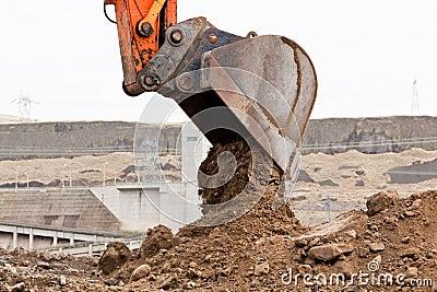 Bucket Unloading Dirt