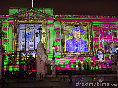 Buckingham Palace projection of Queen s portrait Editorial Image