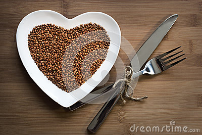 Buckwheat on a heart-shaped plate