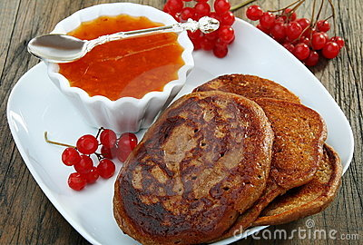Buckwheat pancakes with apricot jam.