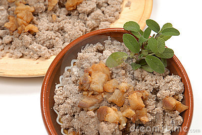 Buckwheat ravioli on a wooden plate (traditional) with cracklings