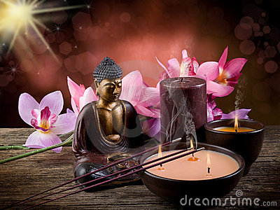 Buddah with candle and incense