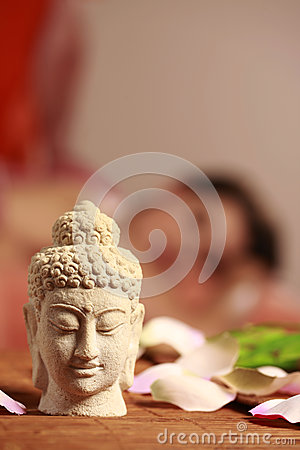 Buddha figurine in massage practice
