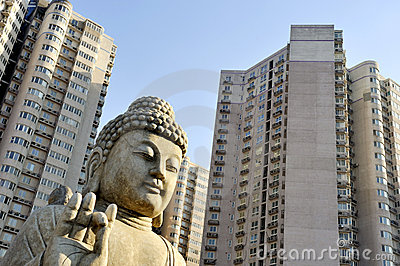 Buddha in front of apartment buildings