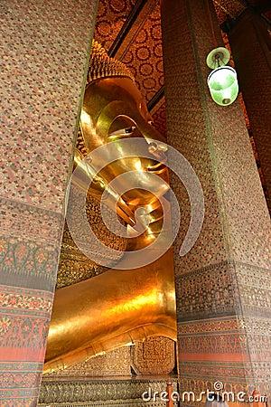 Buddha gold statue in Wat Pho, Bangkok Thailand