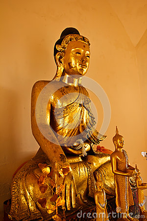 Buddha image made from teakwood with thousand year old in Wat Sr
