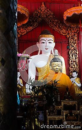 Buddha image on wooden background.