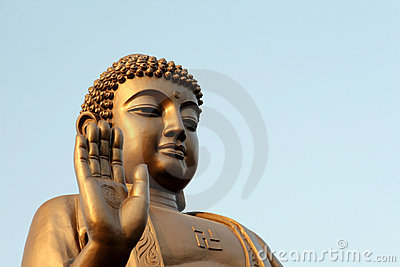 Buddha raises his hand