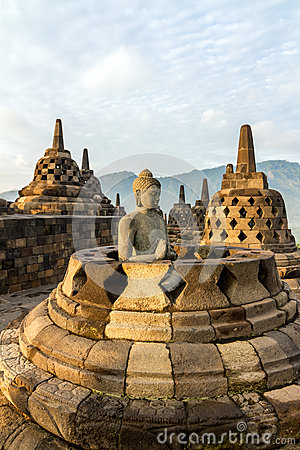 Buddha statue inside stupa of Borobudur temple