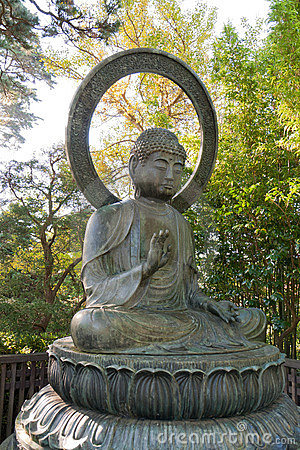 Buddha statue in park with protection gesture