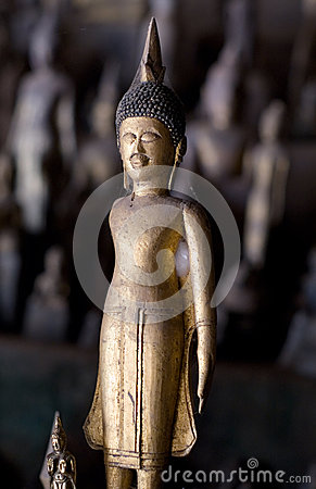 Golden Buddha image in cave
