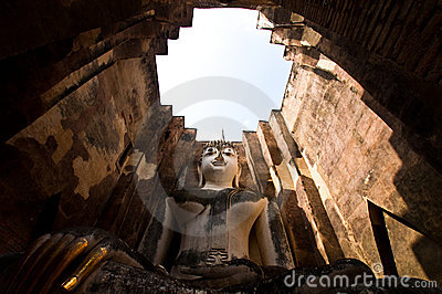 Buddha staue in the temple ruins of sukhothai