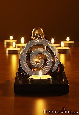 Buddha and tea lights