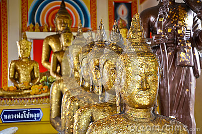 Buddhas in a row in old temple