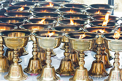 Buddhist butter lamps in temple