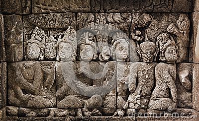 Buddhist carved relief at medieval Borobudur temple on Java, Ind