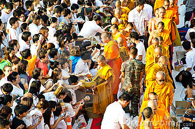 Buddhist charity and merits. Editorial Stock Photo