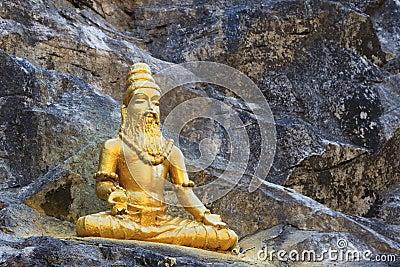 Buddhist golden statue man meditating