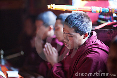 Buddhist monk during puja ceremony Editorial Photo