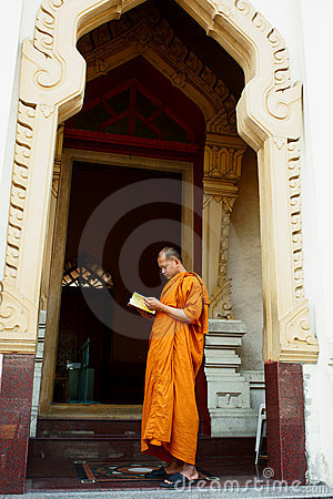 Buddhist Monk reading prayer book Editorial Stock Photo