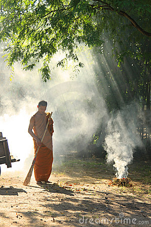Buddhist Monk Yard Work Editorial Stock Image