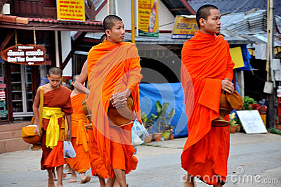 Buddhist Monks alms giving Editorial Photo