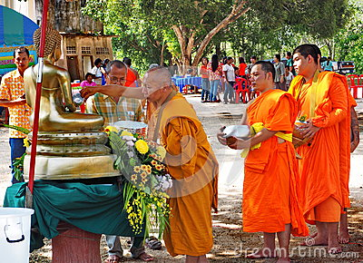 Buddhist monks bathe the Buddha, Songkran festival
